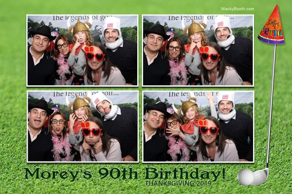guest enjoying custom photobooth rental of moreys 90th birthday celebration in Palo alto